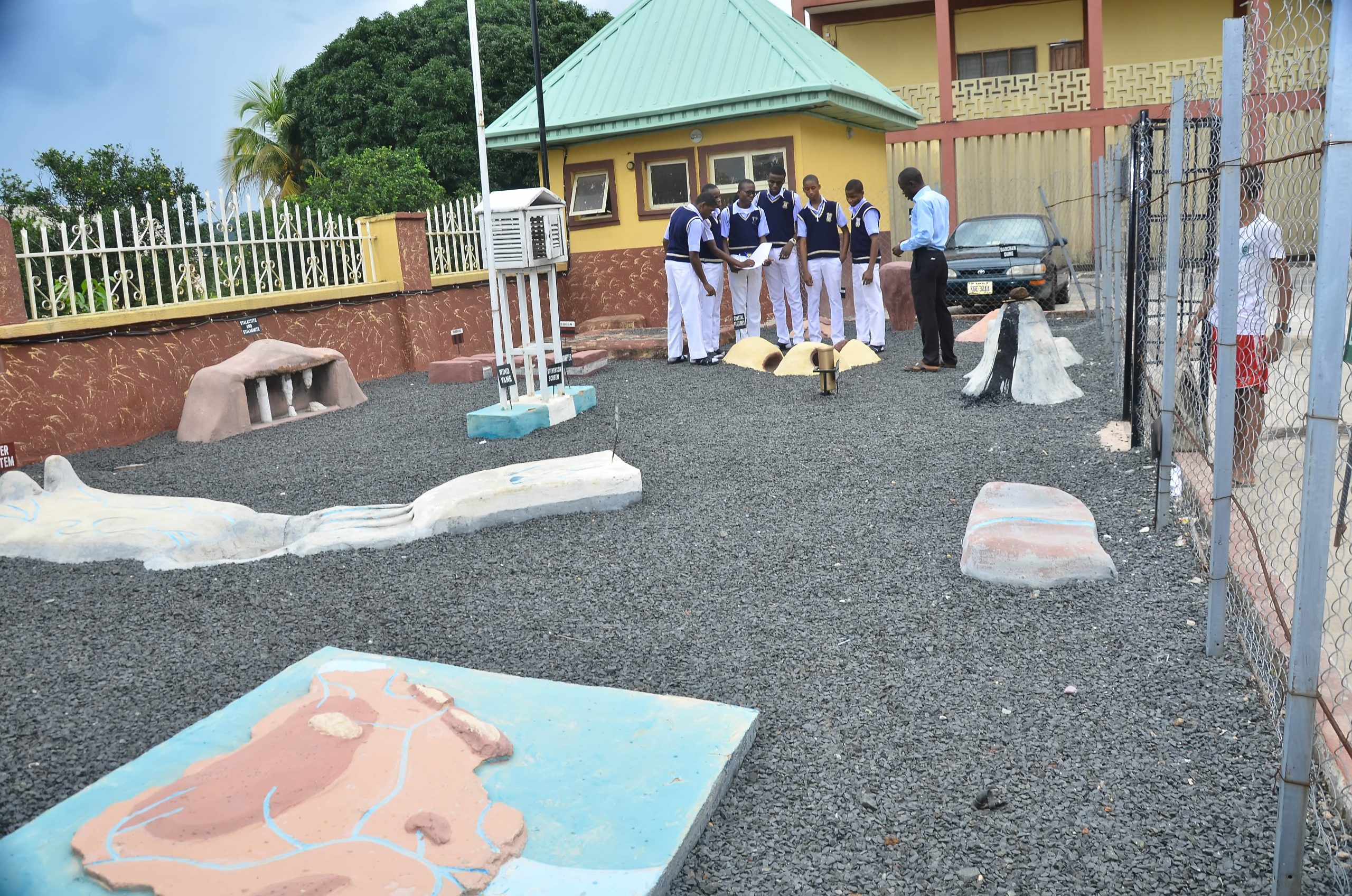 SOME GEOGRAPHY STUDENTS TAKING LESSONS AT THE SCHOOL'S GEOGRAPHY GARDEN